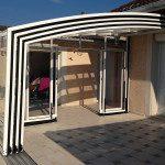 Vérandas : Véranda mobile 4 éléments rétractée, fond avec doubles portes
