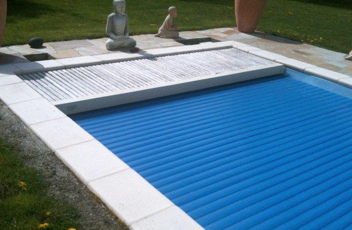 Piscine extérieure avec volet immergé, hivernage de la piscine