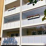 Fermeture de balcon coulissant-pivotant, immeuble